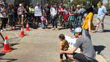 Neighbors march to demand officials make busy road safer for pedestrians