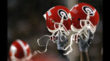 Helmets of the Georgia Bulldogs are held high after their 20-16 victory over the South Carolina Gamecocks at Williams-Brice Stadium on September 11, 2004 in Columbia, South Carolina. (Photo by Streeter Lecka/Getty Images)
