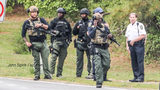 Officers on scene of the shooting in Henry County. (Photo: John Spink, AJC)