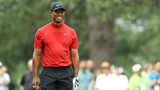 Tiger Woods of the United States smiles on the ninth hole during the final round of the Masters at Augusta National Golf Club on April 14, 2019 in Augusta, Georgia. (Photo by Mike Ehrmann/Getty Images)