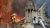 Flames and smoke are seen billowing from the roof at Notre-Dame Cathedral April 15, 2019 in Paris, France. A fire broke out on Monday afternoon and quickly spread across the building, collapsing the spire.