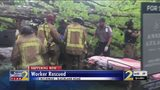 Massive oak tree falls on box truck, trapping driver inside