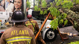 Firefighters taking care of another call a large oak tree fell down onto Engine 26 and delivery truck on the street. (Photo: Atlanta Fire Rescue)