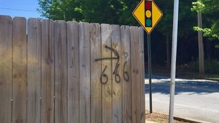 People on edge after satanic symbols spray-painted on fences, church sign