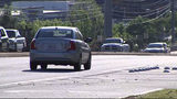 Woman says driver waved his gun during road rage incident