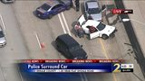 NewsChopper 2 is over the scene and shows several Georgia State Patrol cruisers surrounding a white car with extensive front end damage.