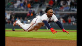 Ozzie Albies #1 of the Atlanta Braves dives safely for third base on his triple hit in the eighth inning against the Chicago Cubs at SunTrust Park on May 16, 2018 in Atlanta, Georgia. (Photo by Kevin C. Cox/Getty Images)
