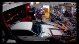 Surveillance video shows the crooks drove a white car into the store. Then seconds later, a red truck drives into the store.