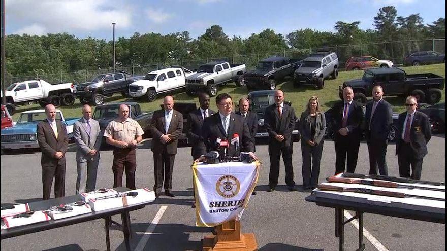 FEDS RAID GEORGIA HOME: Classic cars, souped-up trucks, guns seized