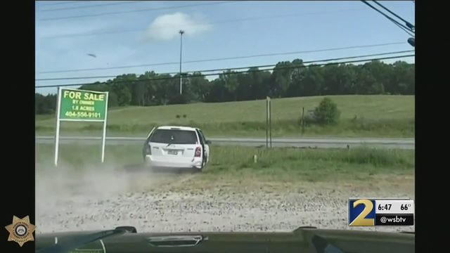 Driver hops curbs, speeds through parking lots during