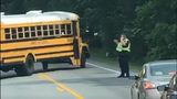 Video shows police officer talking on phone while directing traffic at school