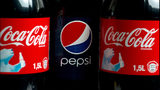 Two bottles of Coca Cola and a bottle of Pepsi Cola are picutred in Berlin, Germany, 06 February 2013.