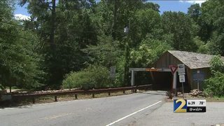 Another driver runs into metal beams protecting historic bridge
