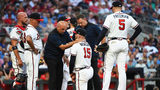 ATLANTA, GEORGIA - JUNE 15: Sean Newcomb #15 of the Atlanta Braves is attended to by training staff after being hit by a ball against the Philadelphia Phillies at SunTrust Park on June 15, 2019 in Atlanta, Georgia. (Photo by Logan Riely/Getty Images)
