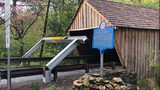 New warning system installed at covered bridge that keeps getting hit by cars