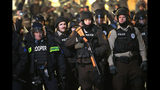Police and national guard tconfront demonstrators outside the police station November 28, 2014 in Ferguson, Missouri. (Photo by Scott Olson/Getty Images)