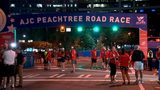 People arriving at the site of the AJC Peachtree Road Race