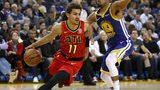 OAKLAND, CA - NOVEMBER 13: Trae Young #11 of the Atlanta Hawks drives on Quinn Cook #4 of the Golden State Warriors at ORACLE Arena on November 13, 2018 in Oakland, California.