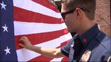 Firefighter with colorblindness gets glasses to help him see American flag