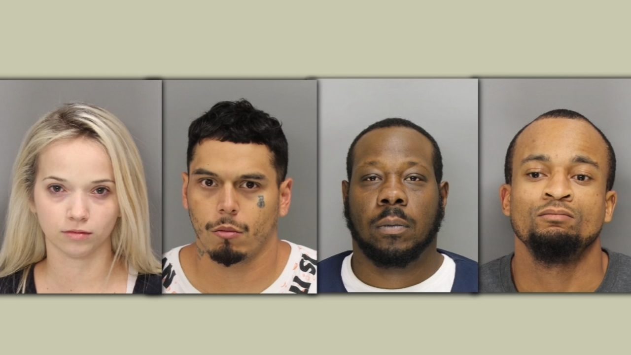 4 arrested after police say they find drugs, guns and cash