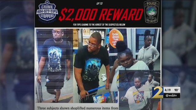 Group shoplifts, points gun at Walmart manager, police say