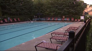 Gunman on the run after two shot at community pool, police say