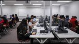 """Students in Georgia did better on the state-standardized tests this last school year, with a larger percentage scoring on track to graduate """"college and career ready."""" (Photo via AJC)"""