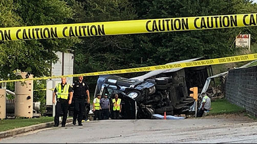 Driver dead after truck flips over on busy road in Clayton