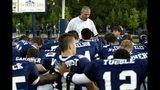 Fomer Northview coach Don Savage, shown praying with his players before a game, died on Dec. 12 at age 51.