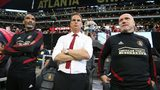 Atlanta United head coach Frank de Boer (center) and assistant coaches Orlando Trustfull (left) and Bob de Klerk lead the team in a 2-1 victory over New York City FC. Curtis Compton/ccompton@ajc.com