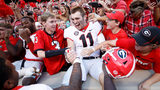 Jake Fromm #11 of the Georgia Bulldogs celebrates with fans. (Photo by Joe Robbins/Getty Images)