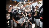 Braves players celebrate clinching the National League East title with a 6-0 victory over the San Francisco Giants on Friday.