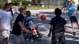 Heartwarming video shows 5th graders play hoops with student in wheelchair