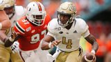 James Graham #4 of the Georgia Tech Yellow Jackets scrambles away from Jonathan Garvin #97 of the Miami Hurricanes during the first half at Hard Rock Stadium on October 19, 2019 in Miami, Florida. (Photo by Michael Reaves/Getty Images)