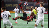 Atlanta United forward Josef Martinez makes a bicycle kick between Philadelphia Union defenders Auston Trusty and Jack Elliott that was blocked by goalkeeper Andre Blake. Curtis Compton/ccompton@ajc.com