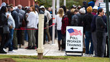 People wait in a long line to vote Saturday at the Cobb County Board of Elections and Registration office in Marietta, GA October 27, 2018. STEVE SCHAEFER / SPECIAL TO THE AJC