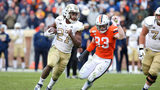Jordan Mason #27 of the Georgia Tech Yellow Jackets rushes past Zane Zandier #33 of the Virginia Cavaliers in the second half during a game at Scott Stadium on November 9, 2019 in Charlottesville, Virginia. (Photo by Ryan M. Kelly/Getty Images)