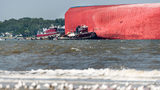 FILE: Emergency responders work to rescue crew members from a capsized cargo ship on September 9, 2019 in St Simons Island. (Photo by Sean Rayford/Getty Images)