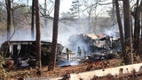 Firefighters at the scene of a mobile home fire