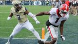 Georgia wide reciever George Pickens is pushed out of bounds by Georgia Tech defensive back Tre Swilling defending on a pass from Jake Fromm during the third quarter in a NCAA college football game on Saturday, November 30, 2019, in Atlanta.