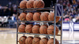 A detailed view of a Northwestern Wildcats basketball rack with Under Armour basketballs is seen during a college basketball game between the Northwestern Wildcats and the Brown Bears on December 30, 2017, at the All State Arena in Rosemont, IL.
